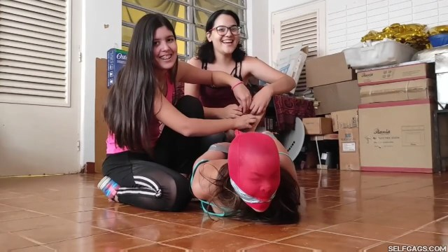 Barefoot bdsm girl hogtied and pantyhose encased by friends