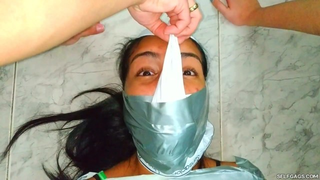 Young panty hooded latina girl duct tape mummified and wrap gagged