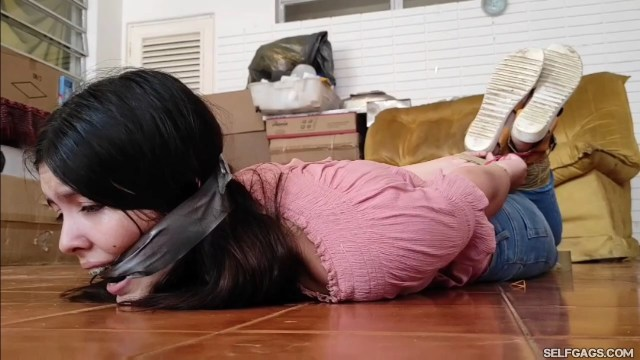 Tape cleave gagged and duct tape hogtied damsel with pink blouse and white sneakers