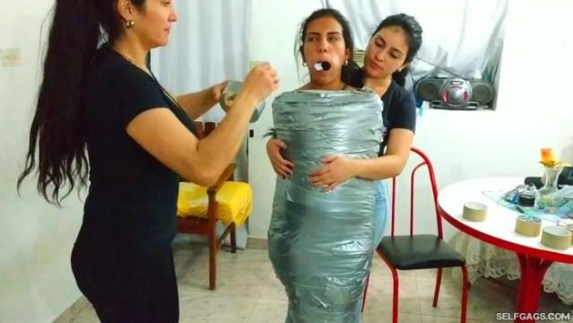 Young Latina Mummified And Panty Hooded