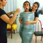 Gagged Latina Girl Wrapped In Sheets And Mummified With Duct Tape Bondage
