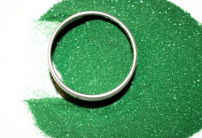 green glitter powder in and around aluminium tin