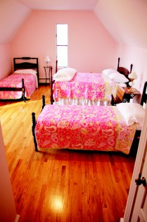 Three pink twin beds at the house at Gaie Lea