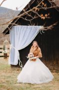 A bride by the barn at Gaie Lea in Staunton, Virginia