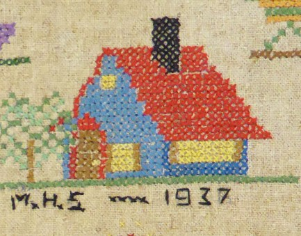 Cross stitched images with date of 1937 in back stitch
