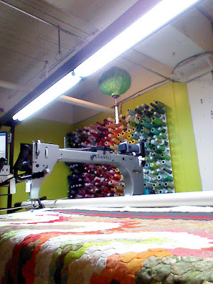 quilt being basted on longarm