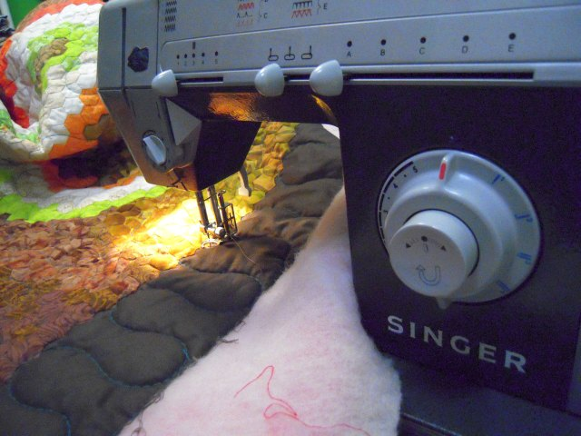 free motion quilting the dragon quilt