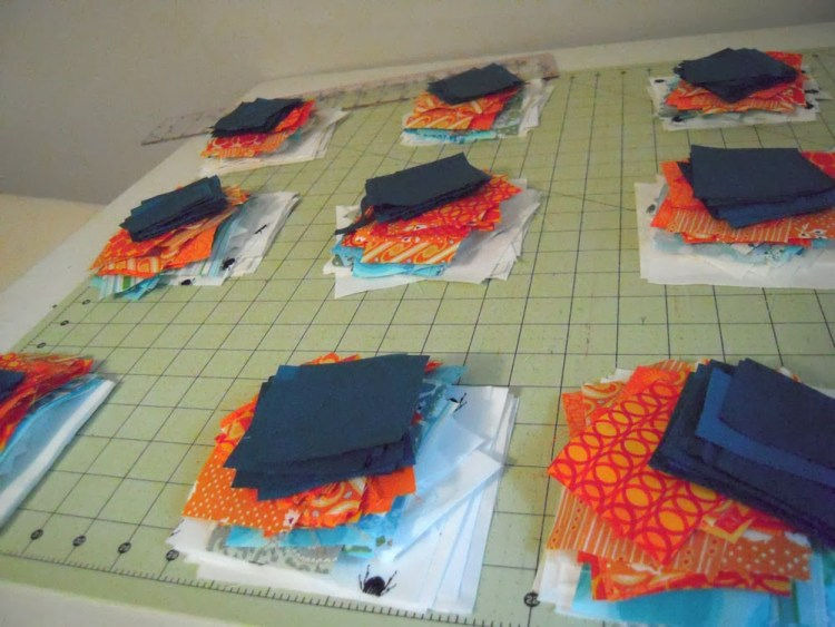 Piles of cut fabrics for quilt