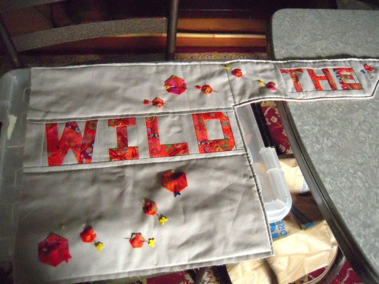 Quilted sign
