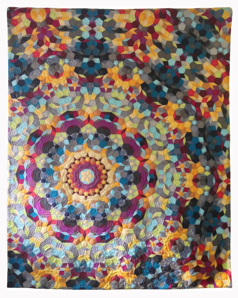 Kaleidoscope hand pieced quilt