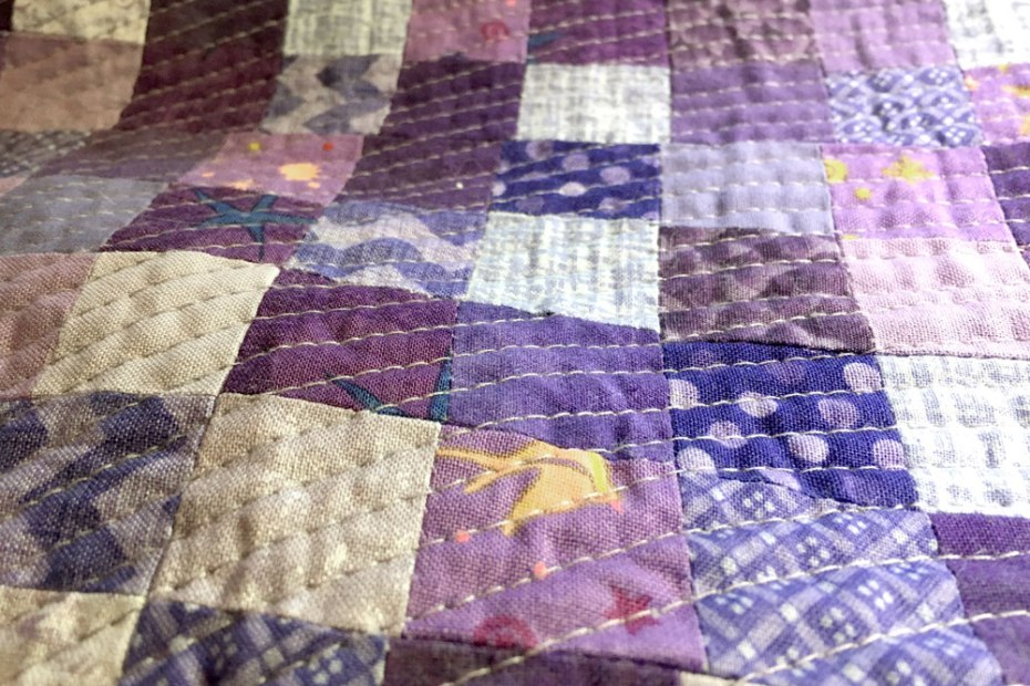 quilting on a purple quilt top