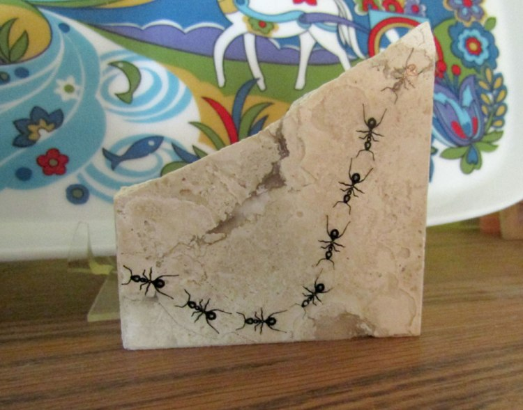 Screen print of ants on a broken stone tile