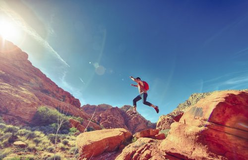 rsz_athletic_man_jumping_between_rocks_in_outdoor_national_park