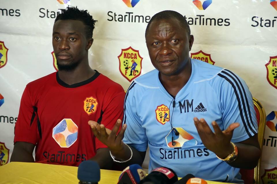 KCCA FC head Coach, Mike Mutebi (R) with midfielder, Sadam Juma