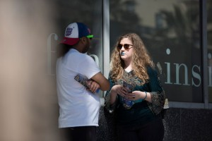 C.L. Kagmi talking with a stranger.