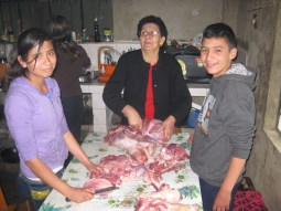 Everyone gets involved in slicing up the meat.