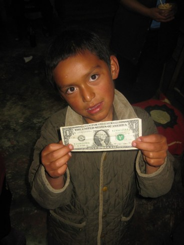 Jheik excited about his gift from us, an authentic one dollar bill.