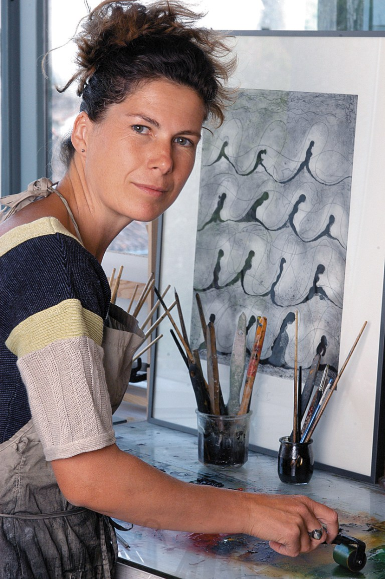 Portrait of Anne Turlais in her gallery. She is a painter for 40 years. Her work consist of paintings on canvas, engraving, monotypes, original prints.