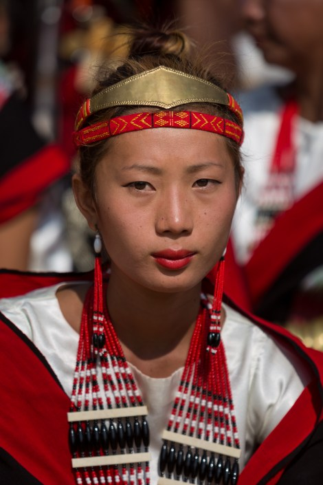 Tribeswoman performing Hornbill Festival 2015, Kisama Village, Kohima District, Nagaland, India. Naga heritage is celebrated during colourful festivals: Hornbill is the Nagaland state government's ten-day festival organised every December, when Naga tribes converge wearing their traditional costumes and finery for tourists.