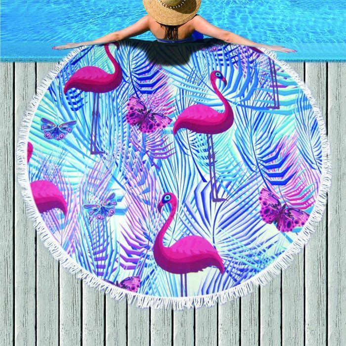 Flamingos stand tall beach towel