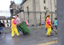 the brightly-colored streetsweepers are always on the job.