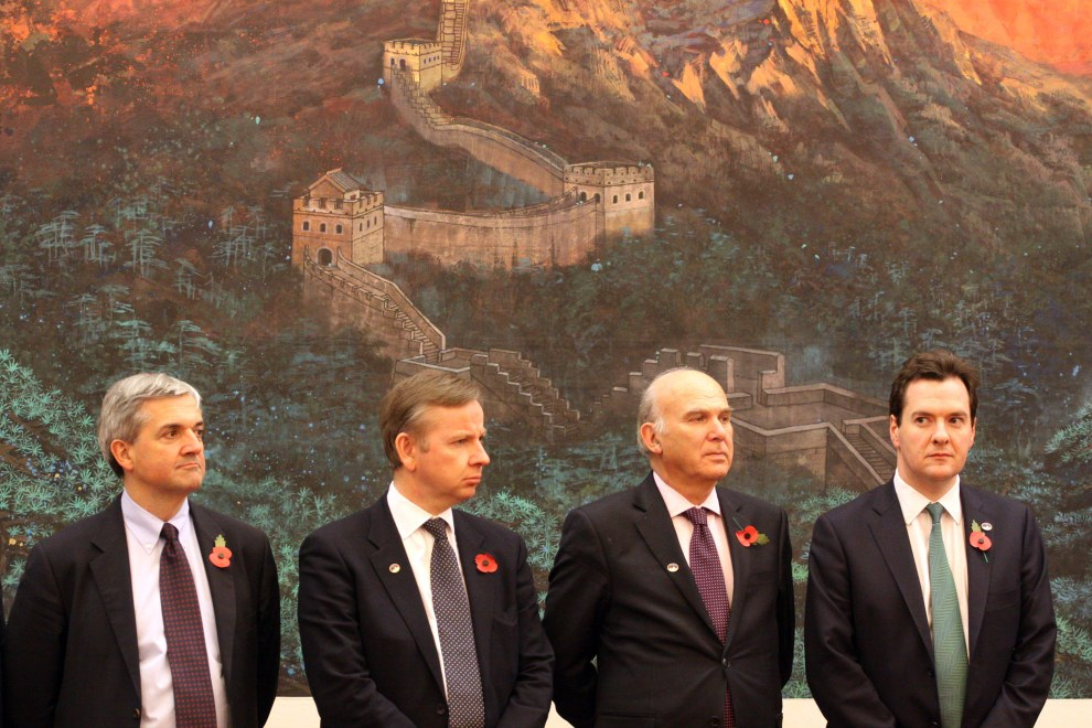 Members of the British government in the Great Hall of the People, in Beijing.
