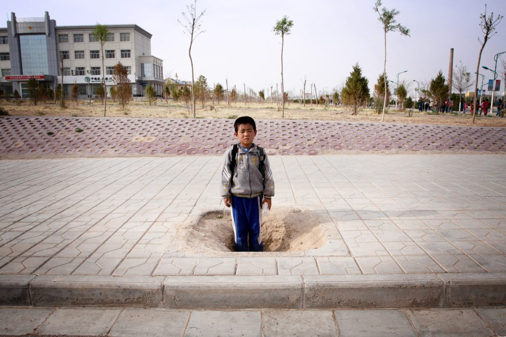 A young boy in the town of Hongsibao, a community that was built in the desert to rehouse refugees relocated from nearby land affected by increasing desertification