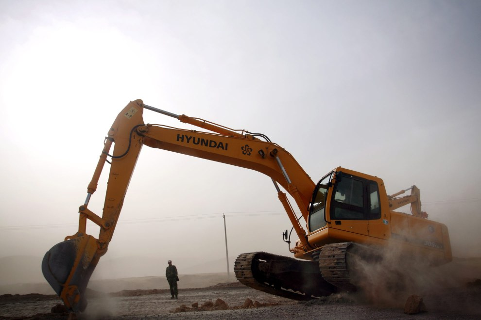 A construction crew working in a sandstorm in Ningxia Province.