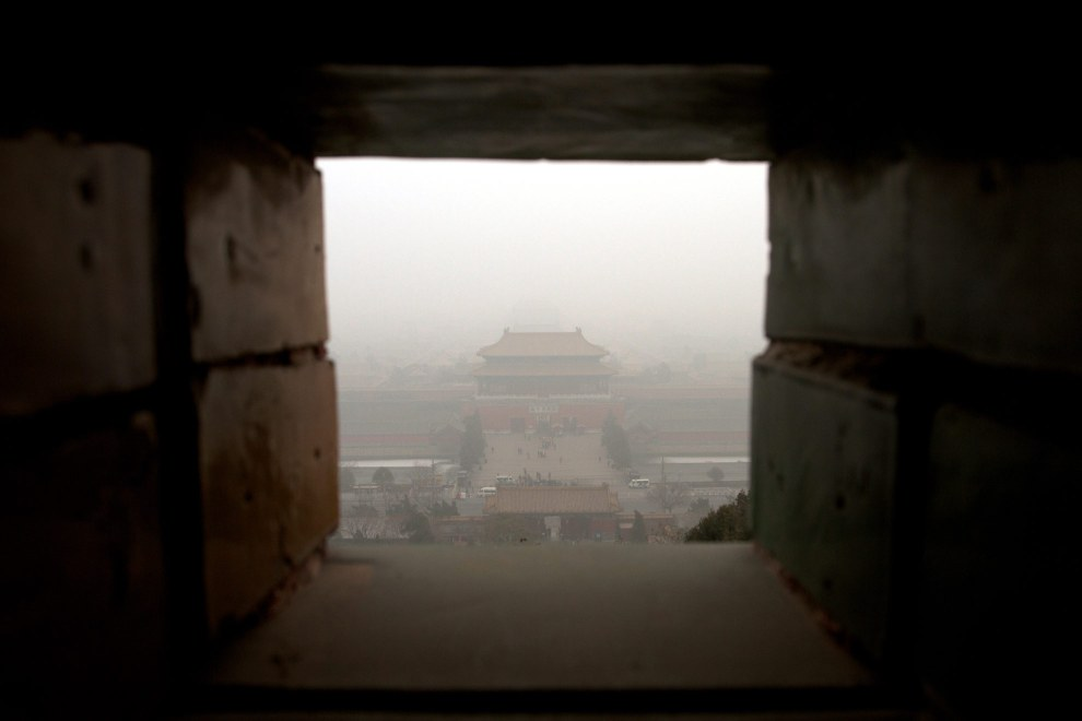 Air pollution obscures the view of the Forbidden City from Coal Hill in central Beijing, China.