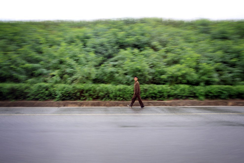 A North Korean man walks along a deserted highway near to the capital, Pyongyang.