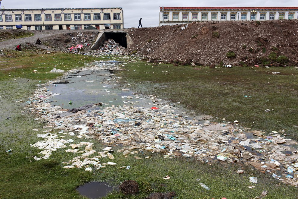 Severe pollution in a waterway in the Tibetan town of Donda, in China's western Qinghai Province. Little education is given to the locals about how to dispose of waste. Failure by the authorities to collect refuse has led to the contamination of many urban water resources.