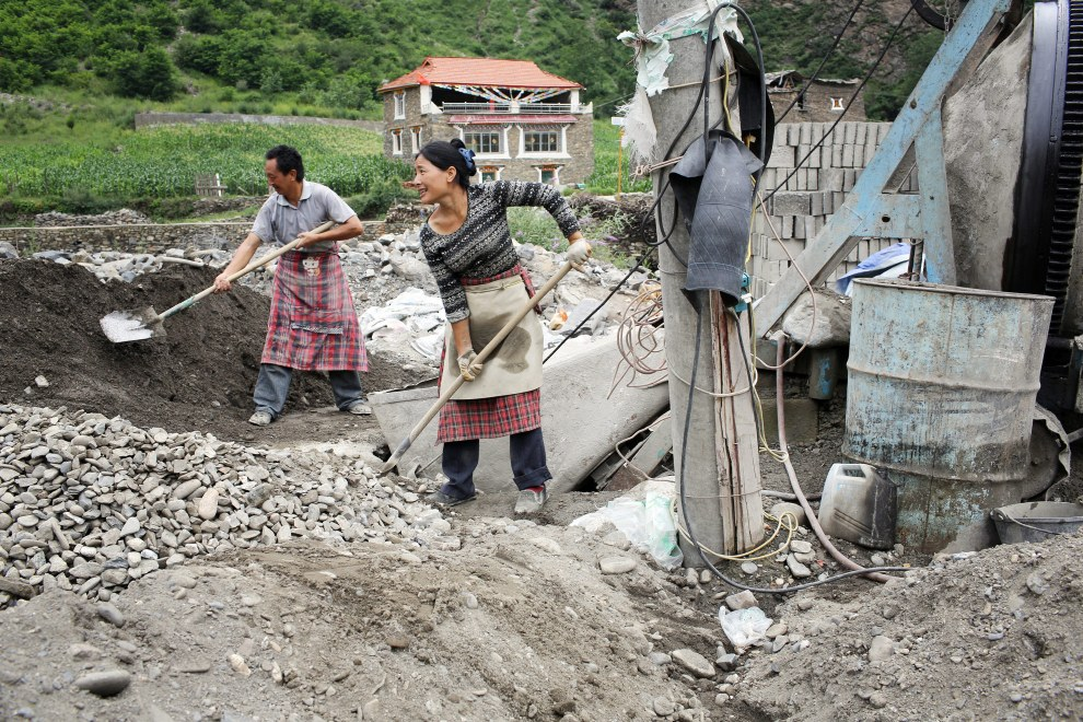 Locals in Heishui town working on a small construction site near to the Heishui River. Construction projects in this area have contributed to a changing landscape on the Tibetan Plateau.