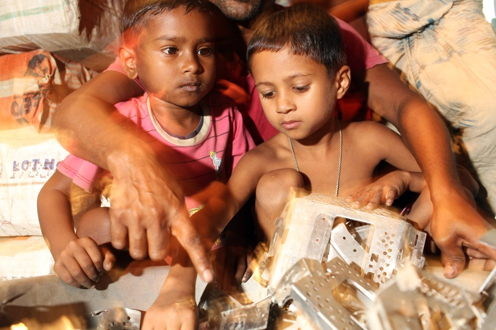 In the village of Sangrampur near Kolkata, children, along with their siblings and parents, collectively dismantle and handle the growing piles of waste.