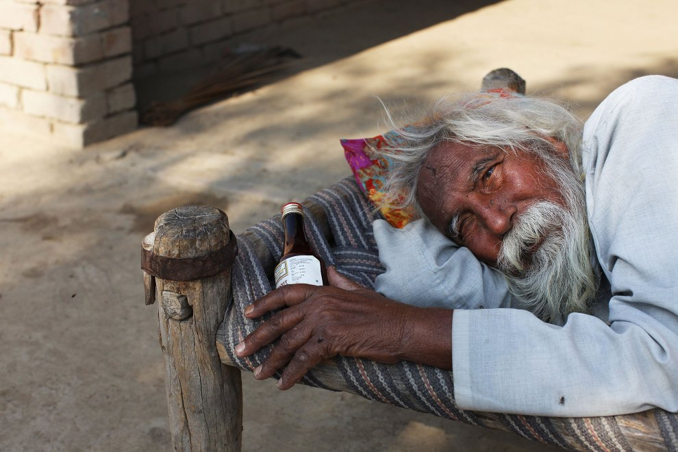"""There's no money, no medicine. I'm waiting for death"", says Harneg Singh, 65, as he lies on a bed outside his home in the Punjab region of northwest India. He is one of many villagers suffering from Hepatitis C. It is believed decades of excessive pesticide use in the region has contributed to weakening people's immune systems, making them more susceptible to diseases. Many villagers cannot afford the expensive treatments and medicines that would either save them of prolong their lives."