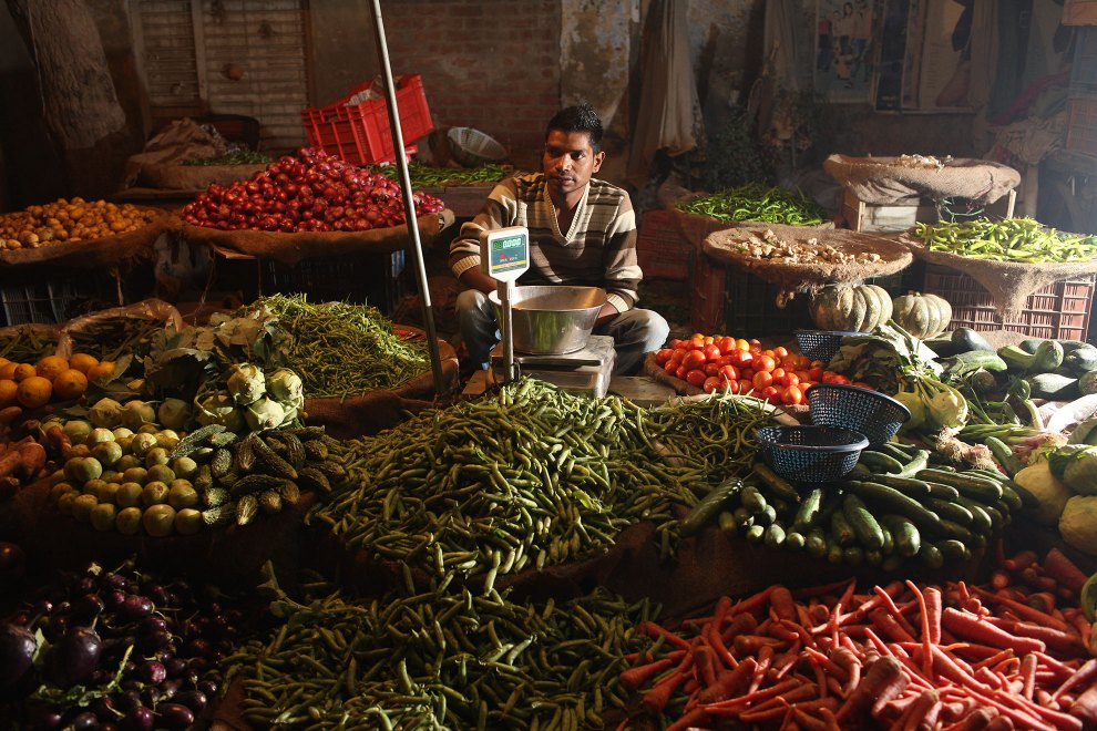 A man sells vegetables at the side of the road in a town in Punjab. Many locally grown vegetables are sold directly to the residents of small communities in Punjab, as well as being exported to other parts of the country.
