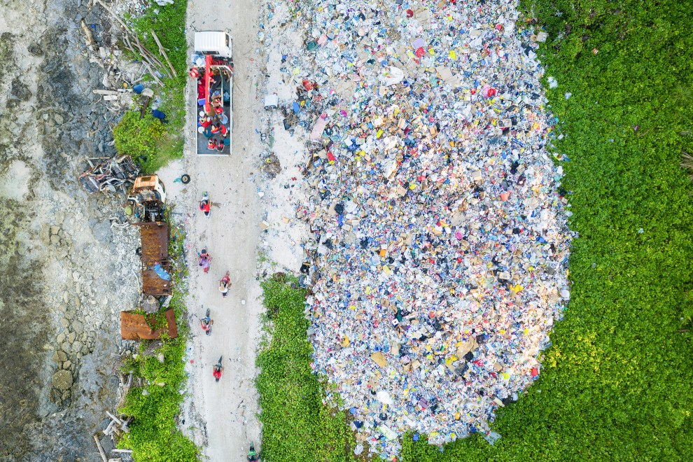 A truck and motorbikes pass through a dumpsite at the northern end of Fongafale island. Waste management is a problem for an island nation such as Tuvalu that's located in a remote corner of the pacific Ocean.