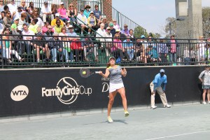 Shelby Rogers returns serve during her match with Grace Min