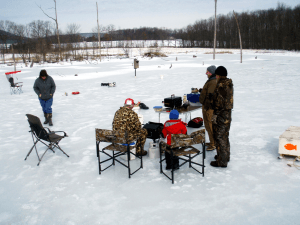 Family ice fishing on a farm pond.