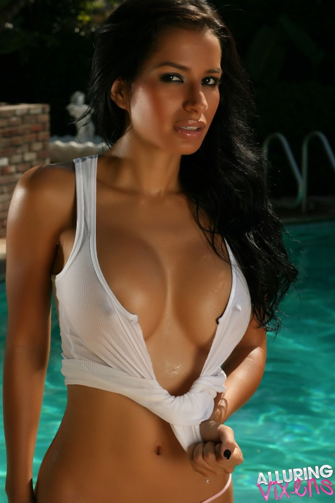 Stunning exotic Alluring Vixen tease Liz shows off her big perky tits by the pool in her wet ripped top