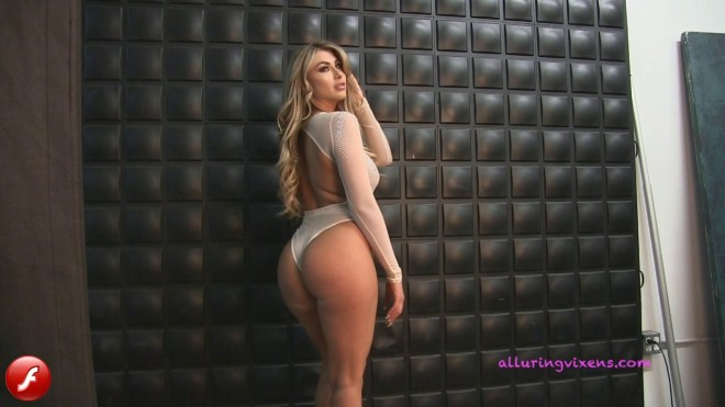 Watch as busty Alluring Vixens babe Melanie Ann tease with her perfect curves in a skimpy semi sheer bodysuit