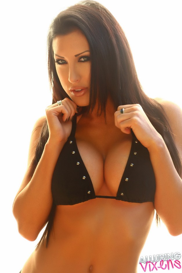 Teasing Alluring Vixen babe Summer shows off her big boobs in her sexy black bikini