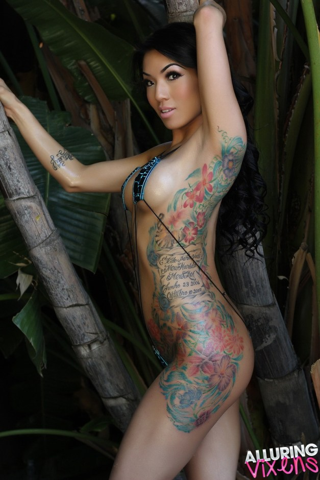 Stunning tattooed Alluring Vixen Yeonji teases with her inked body in a skimpy string bikini