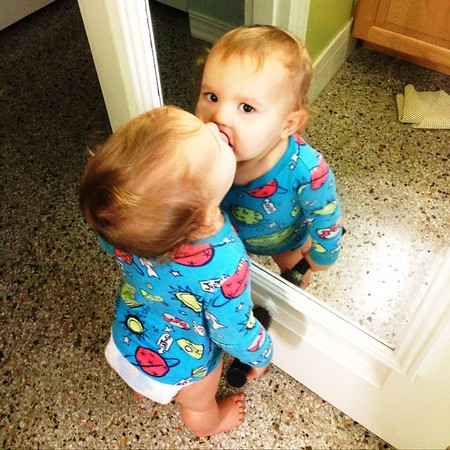 giving the baby kisses