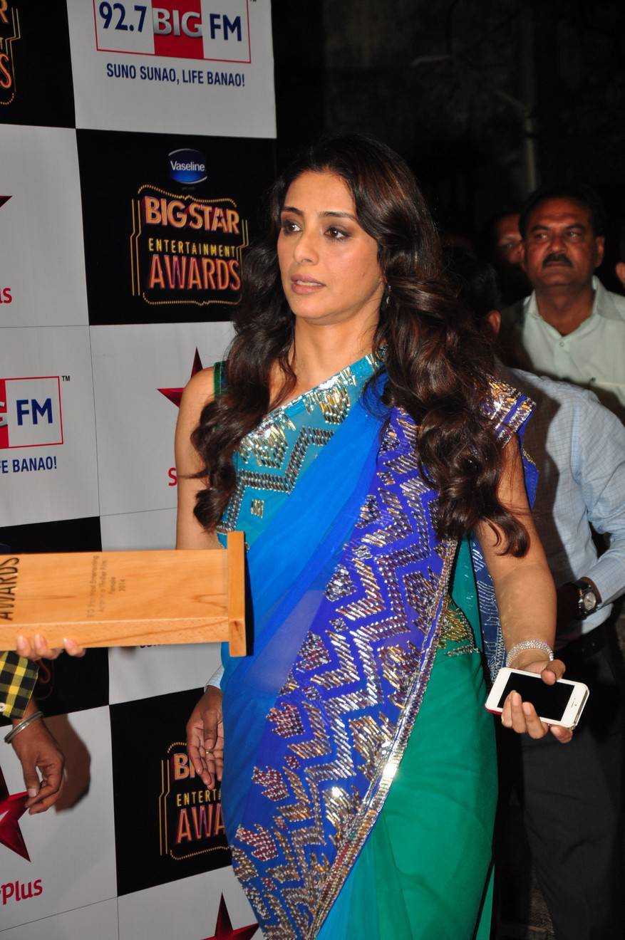 Transparent saree showing Tabu's belly button!