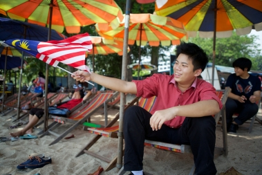 Jason, a Chinese student, connects with his country by waving a flag