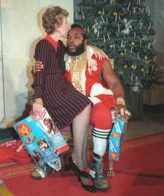 Nancy Reagan sitting on Santa Mr. T's lap