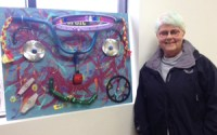 "Artist Winnie Chrzanowski with her adorable assemblage piece, ""Biker Babe"""
