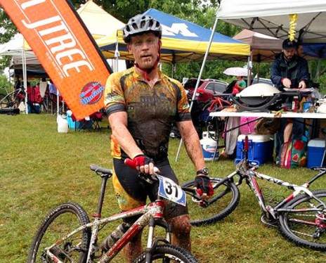 Team Hometown Bicycles Captain Jim Cleer, muddy after a Tree Farm Relay deluge