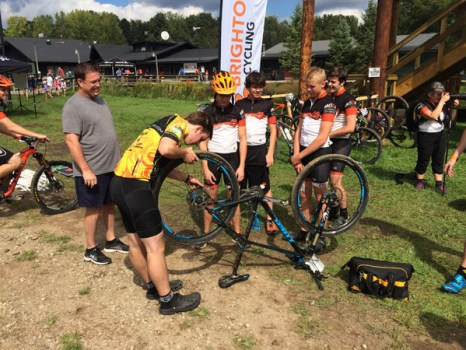 Andrew Jackson helps out the Brighton High School Mountain Bike Team at a MISCA event