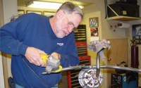 Artist Don Strauss creating one of his sculptures from bicycle parts